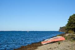 Rowing boat at coast Stock Photos