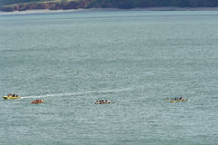 Rowing boat competition in progress at Clovelly, Devon Royalty Free Stock Images
