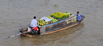 Rowing boat at floating market Mekong River Royalty Free Stock Image