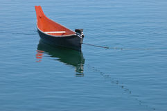 Rowing boat floats on calm lake Stock Image
