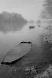 Rowing boat on frozen river Stock Photo