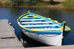 Rowing boat on jetty Stock Images
