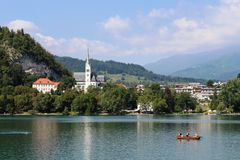 Rowing boat Lake Bled and St Martins Church, Bled Royalty Free Stock Image