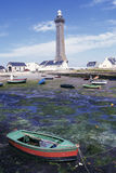 ROWING BOAT AND LIGHT HOUSE, BRITTANY, FRANCE. ROWING BOAT AND LIGHT HOUSE IN SUMMER, BRITTANY, FRANCE Royalty Free Stock Photos