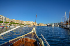 Rowing boat at malta harbor. Under blue sky Royalty Free Stock Photography