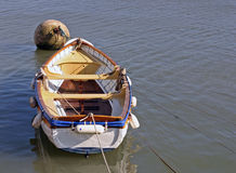 Rowing Boat in marina. A boat anchored in the marina royalty free stock images