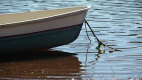 Rowing boat moored at shore stock footage