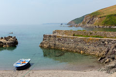 Rowing boat moored in tiny harbour Royalty Free Stock Photo