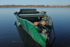 Rowing boat moored to the shore. Spring on the river. Stock Photo