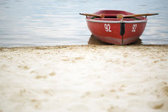 Rowing boat with number 92 at beach stock photo