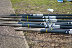 Rowing boat oars on river bank Royalty Free Stock Photos