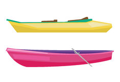 Rowing boat with paddles and canoe. Stock Photos