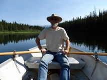 Rowing a boat in the rocky mountains Royalty Free Stock Photos