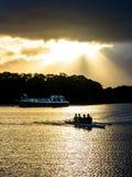 Rowing Boat on Sunset Lake Royalty Free Stock Image