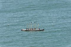 Rowing boat victory ritual at Clovelly, Devon Stock Photo