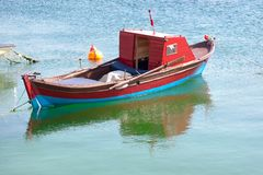 Rowing boat. Wooden red row boat in calm water Stock Images