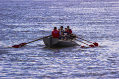 Rowing by the boat Royalty Free Stock Photo