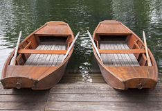 Rowing Boats. Moored at a landing on lake Royalty Free Stock Images