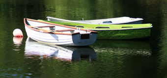 Rowing boats. Three rowing boats moored to a red buoy stock photography