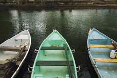 Rowing boats on Annecy canal Stock Photo