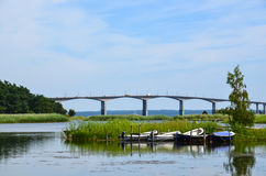 Rowing boats by bridge. Rowing boats by the Oland bridge connecting the island Oland with mainland Sweden Royalty Free Stock Photo
