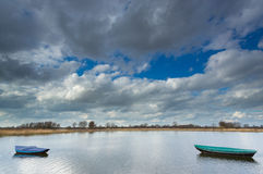 Rowing boats floating on a small lake. Rowing boats floating on a small lake in the Ooijpolder near Nijmegen Stock Images