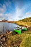 Rowing Boats on the Isle of Harris. Rowing boats on the loch shore on the Golden Road on the Isle of Harris in the Outer Hebrides stock photo
