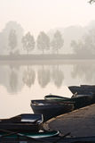 Rowing boats at misty pond Royalty Free Stock Photos