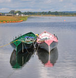 Rowing Boats Moored on a Lake Stock Photo