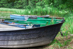 Rowing boats moored by lake Stock Photo
