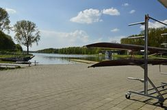 Rowing boats near the lake in the Amsterdam Forest. Amsterdam, Netherlands - May 7, 2016: The olympic rowing lake (Bosbaan) in the forest (Amsterdamse Bos), with Royalty Free Stock Image