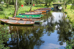 Rowing boats on a peaceful river Royalty Free Stock Photos