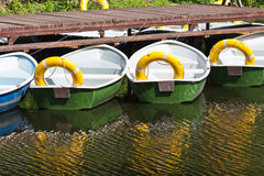 Rowing boats at the pier Stock Photography