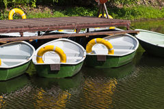 Rowing boats at the pier Royalty Free Stock Photography