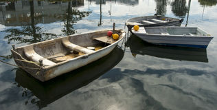 Rowing boats with reflections Stock Photo