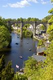 Rowing boats on the river Nidd, Knaresborough. Hire boats on the river Nidd in Knaresborough, Yorkshire, with the railway viaduct in the background and the town Stock Photography