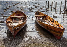 Rowing boats on shore of Derwent Water, Keswick. Royalty Free Stock Image