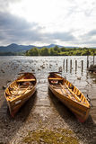 Rowing boats on shore of Derwent Water, Keswick. Royalty Free Stock Photo