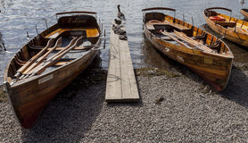 Rowing boats on shore of Derwent Water, Keswick. Stock Photography