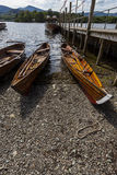 Rowing boats on shore of Derwent Water, Keswick. Stock Images