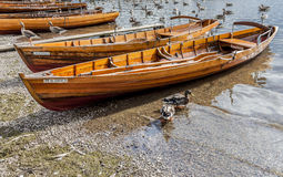 Rowing boats on shore of Derwent Water, Keswick. Royalty Free Stock Images