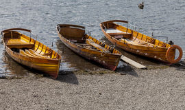 Rowing boats on shore of Derwent Water, Keswick. Royalty Free Stock Photography