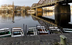 Rowing boats. Standing by the shore under the bridge in Prague Stock Image