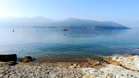 Rowing calm day. Lake Maggiore. Italy royalty free stock image