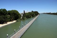 Rowing canal for water sports on the Guadalquivir river in Seville. SEVILLE, SPAIN - JULY 17, 2011: Rowing canal for water sports on the Guadalquivir river in stock photos
