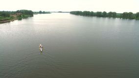 Rowing and Canoeing. The view from the drone on the river swimming athletes Aerial.  stock video