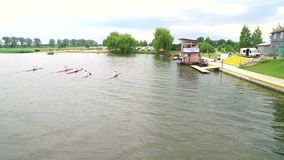 Rowing and Canoeing. The view from the drone on the river swimming athletes Aerial.  stock footage