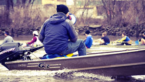 Rowing Coach Giving Direction. Rowing coach gives direction during practice royalty free stock image