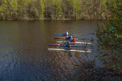 Rowing competitions. Rowers in training in the city pond Royalty Free Stock Photography