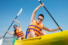 Rowing couple. Happy couple rowing in kayak Stock Photos
